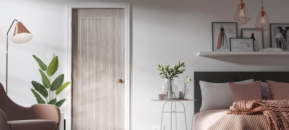 This image is of a Mexicano laminate internal door finished in a light grey