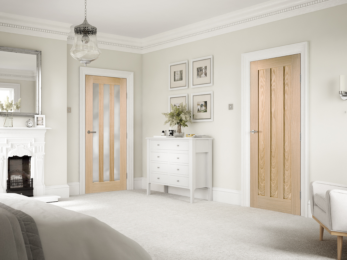 Oak glazed and panel internal doors in a lounge room setting